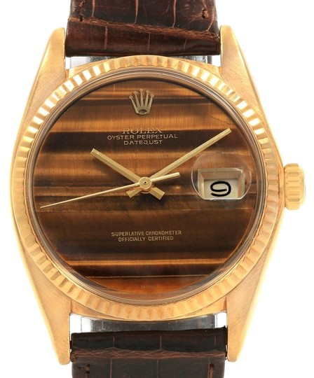 Preload https://img-static.tradesy.com/item/24222524/rolex-tiger-eye-datejust-18k-yellow-dial-vintage-mens-1601-watch-0-1-540-540.jpg
