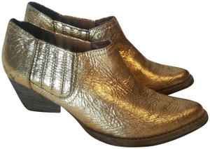 Very Volatile Gold Boots