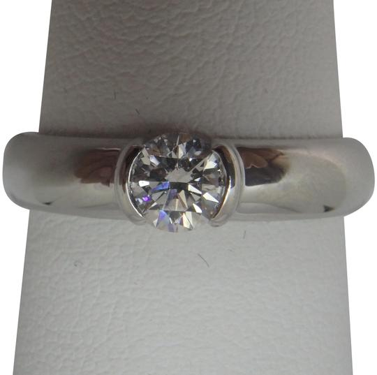 Preload https://img-static.tradesy.com/item/24223815/tiffany-and-co-platinum-and-diamond-etoile-solitaire-ring-0-1-540-540.jpg