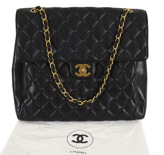 Preload https://img-static.tradesy.com/item/24226835/chanel-classic-quilted-caviar-maxi-flap-black-leather-shoulder-bag-0-3-540-540.jpg