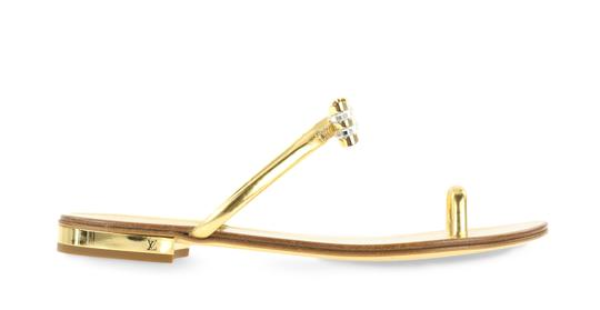 Preload https://img-static.tradesy.com/item/24235341/louis-vuitton-gold-bow-sandals-size-eu-38-approx-us-8-regular-m-b-0-3-540-540.jpg