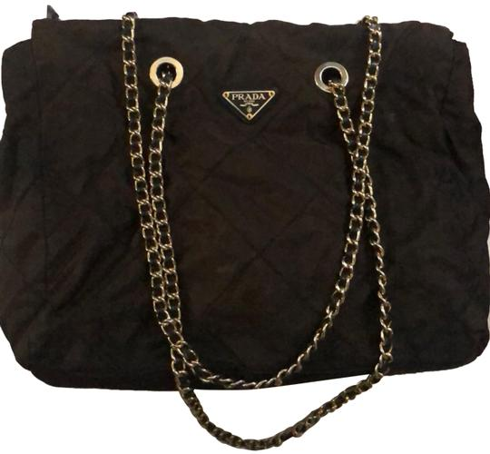 Preload https://img-static.tradesy.com/item/24240009/prada-quilted-with-gold-chain-brown-nylon-tote-0-3-540-540.jpg