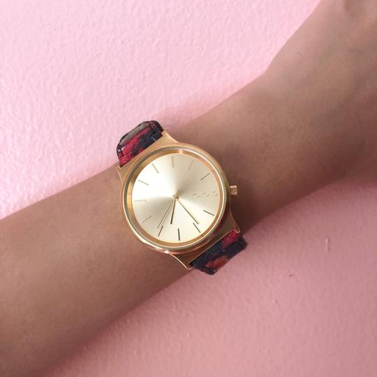 Preload https://img-static.tradesy.com/item/24256091/gold-face-floral-band-watch-0-2-540-540.jpg