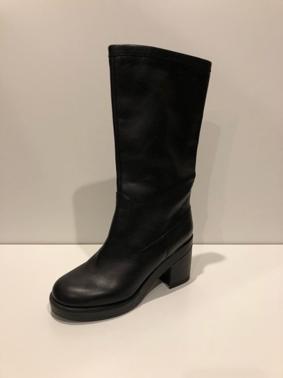 Preload https://img-static.tradesy.com/item/24256112/jil-sander-black-new-tall-leather-bootsbooties-size-eu-37-approx-us-7-regular-m-b-0-1-540-540.jpg