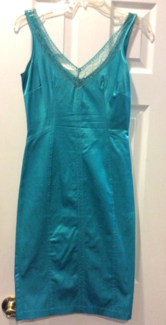 Preload https://img-static.tradesy.com/item/24256253/dolce-and-gabbana-turquoise-satin-mid-length-cocktail-dress-size-4-s-0-2-650-650.jpg