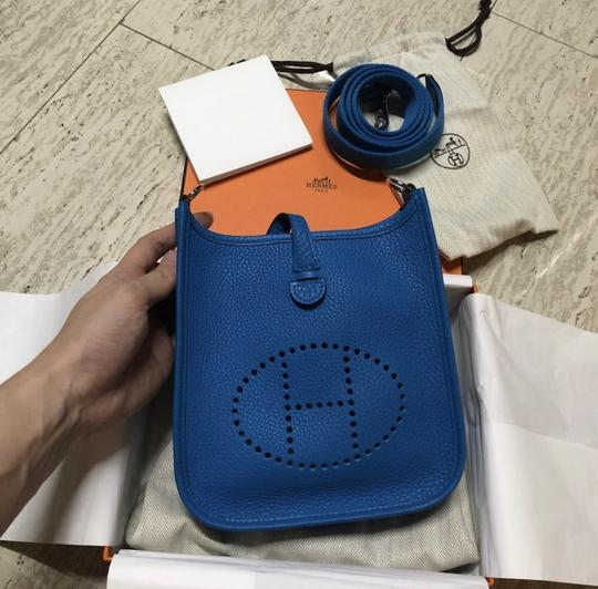 Preload https://img-static.tradesy.com/item/24256362/hermes-evelyne-mini-zanzibar-blue-leather-cross-body-bag-0-0-540-540.jpg