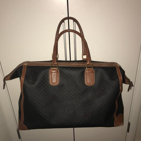 Preload https://img-static.tradesy.com/item/24256448/gucci-tote-guccissima-black-and-brown-leather-weekendtravel-bag-0-2-540-540.jpg
