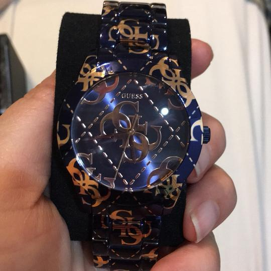 Preload https://img-static.tradesy.com/item/24256496/guess-navy-and-gold-watch-0-2-540-540.jpg