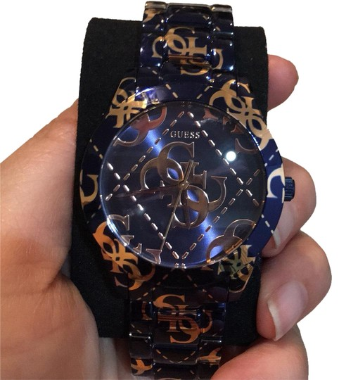 Preload https://img-static.tradesy.com/item/24256496/guess-navy-and-gold-watch-0-3-540-540.jpg