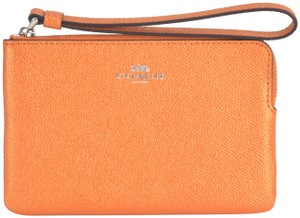 27a70eaaab Orange Leather Coach Wristlets - Up to 70% off at Tradesy