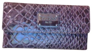 b6ec7de3ed Added to Shopping Bag. Guess Baguette. Guess E.g Dark Purple Snakeskin  Leather Baguette