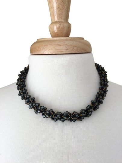 Preload https://img-static.tradesy.com/item/24268859/grey-black-and-gold-twisted-beaded-necklace-0-1-540-540.jpg