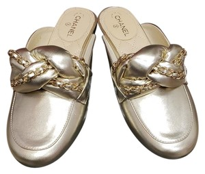 Chanel New 37.5 Light Gold Mules