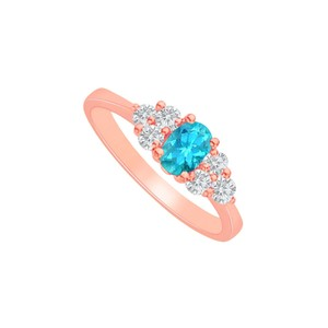 DesignerByVeronica Blue Topaz and CZ Seven Stones Ring in 14K Rose Gold