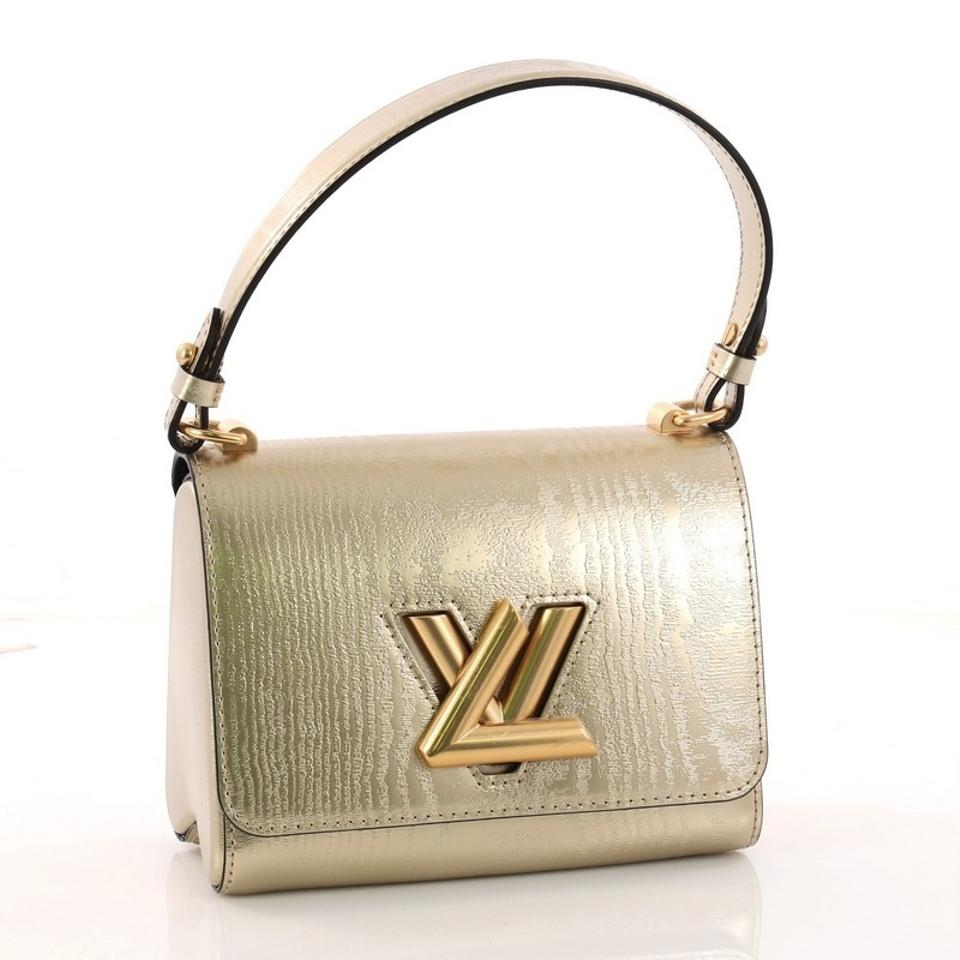 Louis Vuitton Twist Handbag Gravity Pm Gold Calfskin Leather Shoulder Bag -  Tradesy 66885503269b9