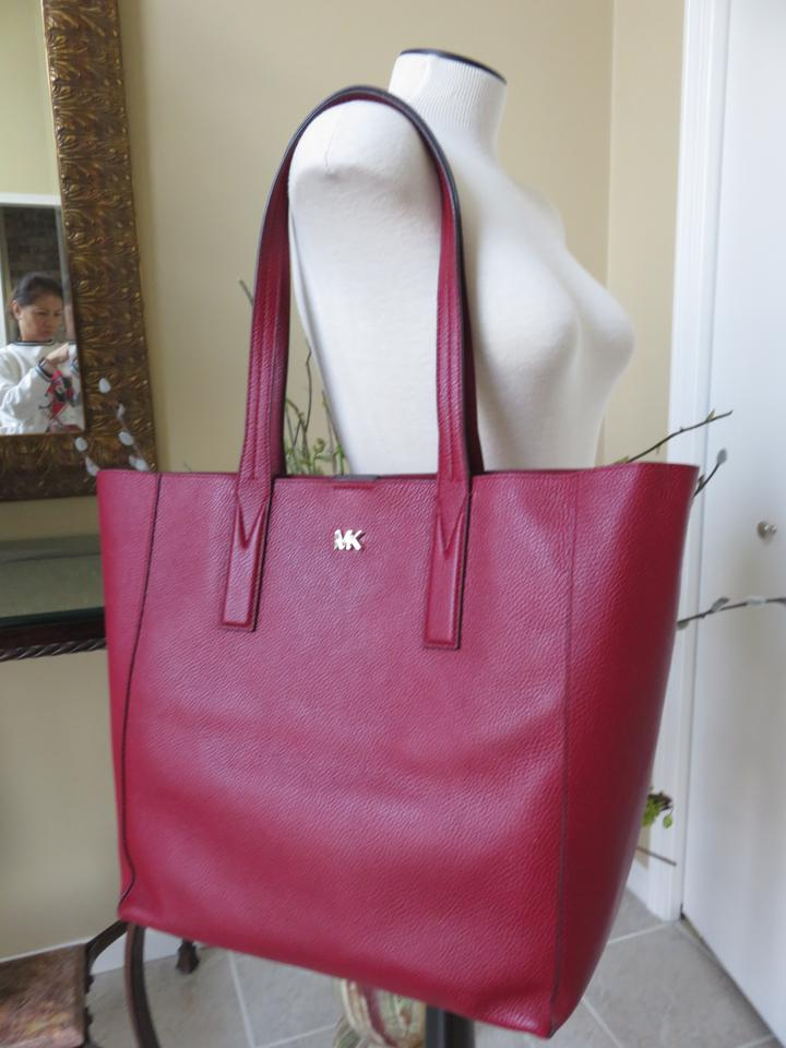 296a1a72cb80 Michael Kors Mk Signature Pebbled Leather Large Gold-tone Hardware Tote in  Maroon Image 8. 123456789