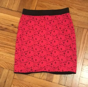 Silence + Noise Mini Skirt hot pink with black detail.