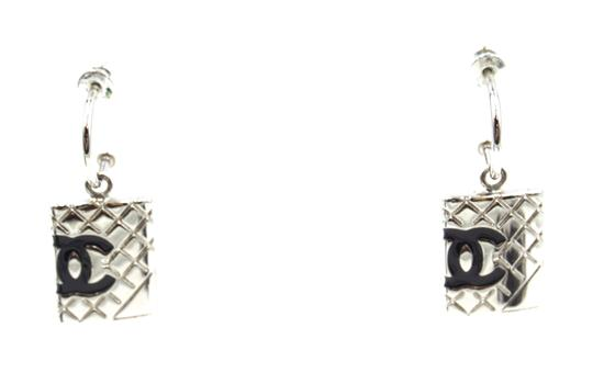 Preload https://img-static.tradesy.com/item/24285528/chanel-23483-black-silver-cambon-cc-drop-dangle-pierced-stud-earrings-0-1-540-540.jpg