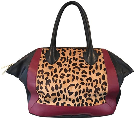 Preload https://img-static.tradesy.com/item/24286711/crown-vintage-leopard-print-calf-hair-winged-with-marsalaoxblood-accents-blackmarsalaoxblood-leather-0-3-540-540.jpg