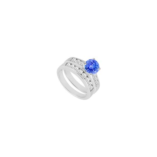Preload https://img-static.tradesy.com/item/24287178/blue-created-tanzanite-cubic-zirconia-engagement-with-wedding-band-set-ring-0-0-540-540.jpg