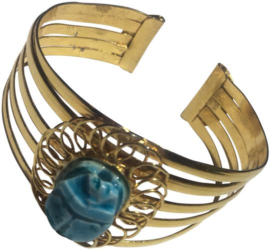 Preload https://img-static.tradesy.com/item/24287662/blue-gold-wire-scarab-stone-bracelet-0-3-540-540.jpg