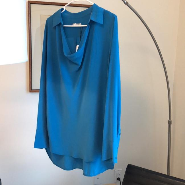Preload https://img-static.tradesy.com/item/24290354/vince-turquoise-silk-tunic-in-bay-blouse-size-12-l-0-2-650-650.jpg