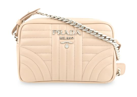 Preload https://img-static.tradesy.com/item/24290572/prada-nude-cipria-diagramme-camera-quilted-bandoliera-beige-leather-cross-body-bag-0-2-540-540.jpg