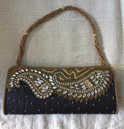 Preload https://img-static.tradesy.com/item/24290686/sequin-clutchstrap-black-and-gold-fabric-and-beads-clutch-0-0-540-540.jpg