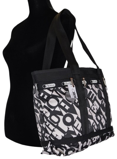 Preload https://img-static.tradesy.com/item/24295480/lesportsac-new-medium-carry-on-purse-love-is-bold-polyester-weekendtravel-bag-0-3-540-540.jpg