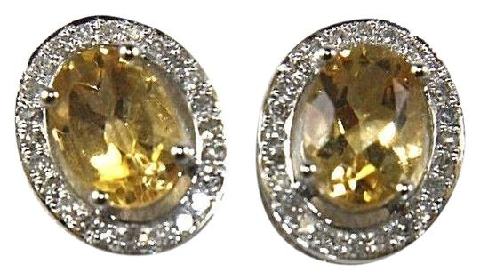 Preload https://img-static.tradesy.com/item/24296867/yellow-and-silver-oval-citrine-diamond-halo-stud-14k-white-gold-51ct-earrings-0-1-540-540.jpg