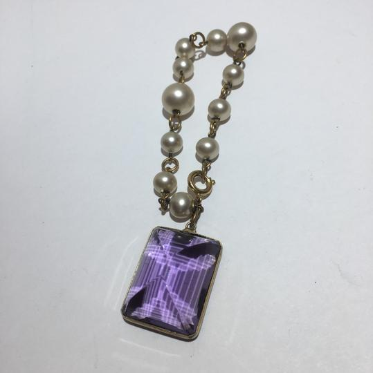 Preload https://img-static.tradesy.com/item/24297523/purple-pearl-link-glass-faceted-crystal-charm-bracelet-0-2-540-540.jpg