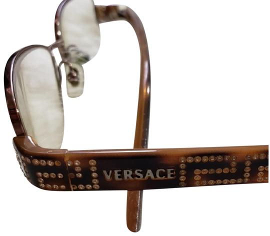 Preload https://img-static.tradesy.com/item/24297546/versace-collection-1134-b-copper-copper-metal-frame-with-crystals-and-logo-on-sides-glasses-are-in-e-0-10-540-540.jpg