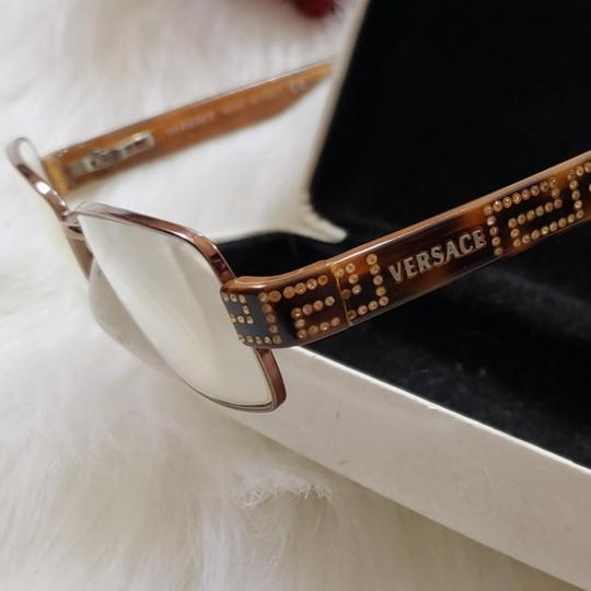 Versace Collection VERSACE EYEGLASSES 1134-B COPPER COPPER METAL FRAME WITH CRYSTALS AND VERSACE LOGO ON SIDES. Glasses are in excellent condition, case is dented. Please ask questions