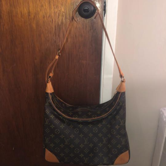 Preload https://img-static.tradesy.com/item/24297660/canvas-and-mm-cowhide-leather-hobo-bag-0-3-540-540.jpg