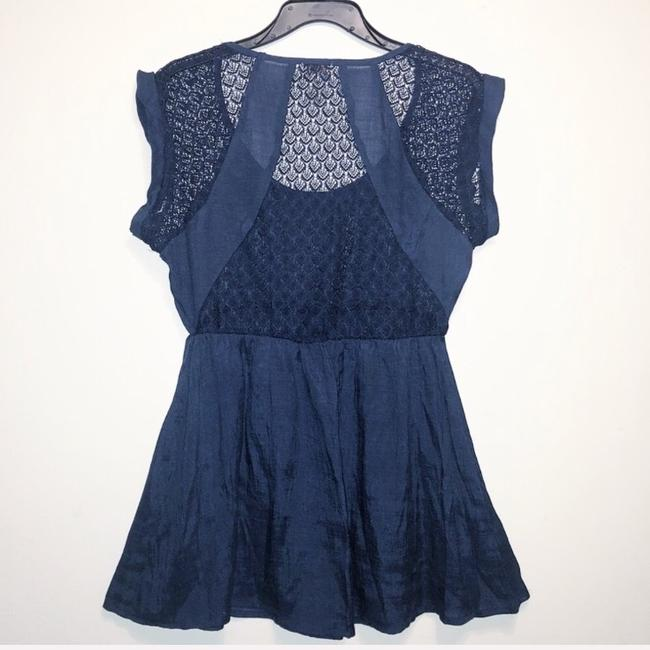 Preload https://img-static.tradesy.com/item/24297679/eyelash-couture-blue-empire-waist-lace-blouse-size-8-m-0-2-650-650.jpg