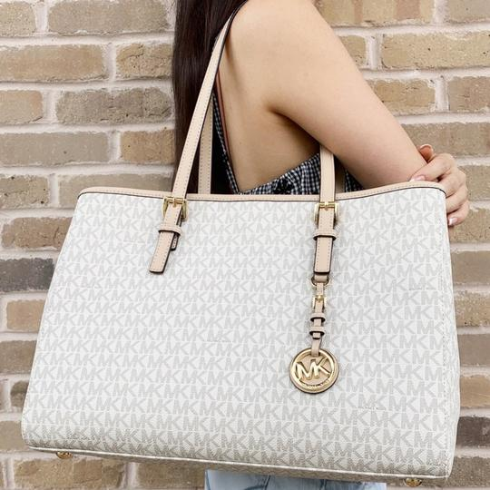 Preload https://img-static.tradesy.com/item/24297694/michael-kors-jet-set-travel-large-east-west-mk-signature-vanilla-leather-tote-0-2-540-540.jpg
