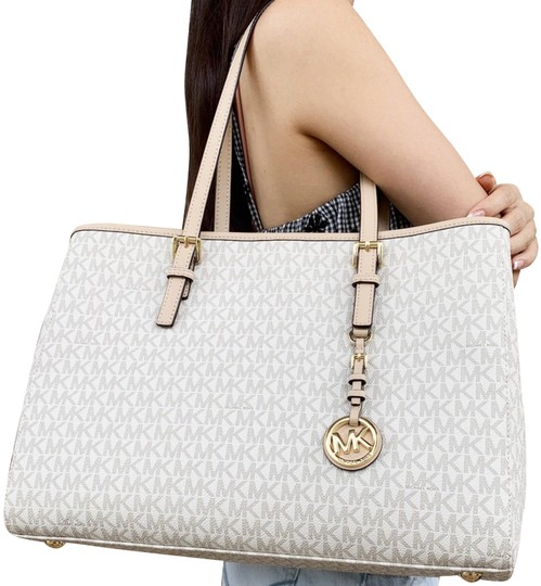 Preload https://img-static.tradesy.com/item/24297694/michael-kors-jet-set-travel-large-east-west-mk-signature-vanilla-leather-tote-0-3-540-540.jpg