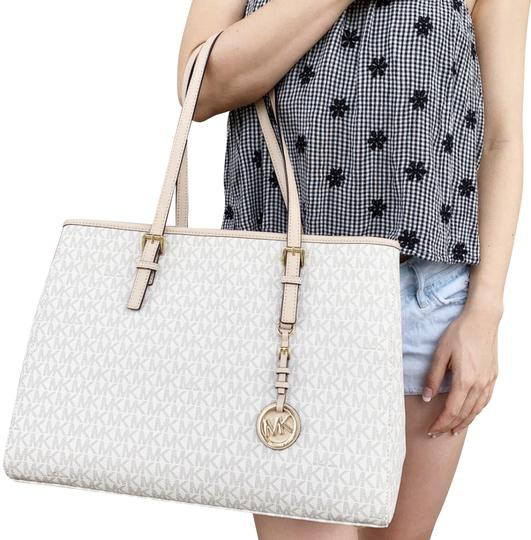 Preload https://img-static.tradesy.com/item/24297706/michael-kors-jet-set-travel-large-east-west-mk-signature-vanilla-leather-tote-0-3-540-540.jpg