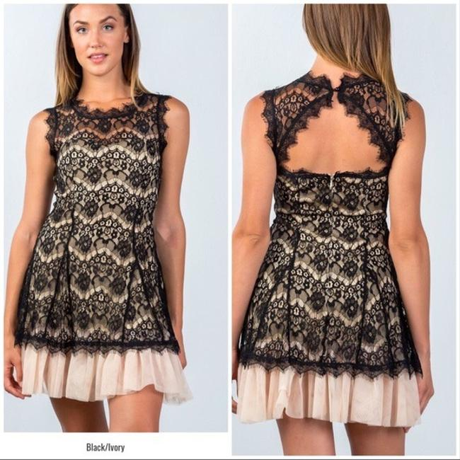 Preload https://img-static.tradesy.com/item/24297902/casting-black-and-cream-sweet-sleeveless-lace-tulle-hem-mid-length-night-out-dress-size-14-l-0-2-650-650.jpg