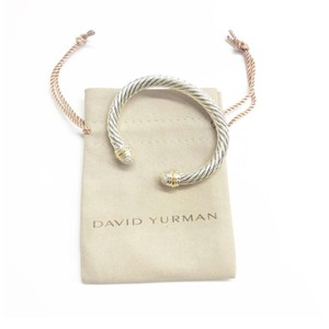 David Yurman David Yurman Pavé Diamond Two Tone Classic Cable Cuff Bracelet Sterling silver and 18k yellow gold Beautiful pavé style diamonds at both ends of bangle with 18k yellow gold bands Small, 7mm 100% Authentic Guaranteed Comes inside original David Yurman pouch!
