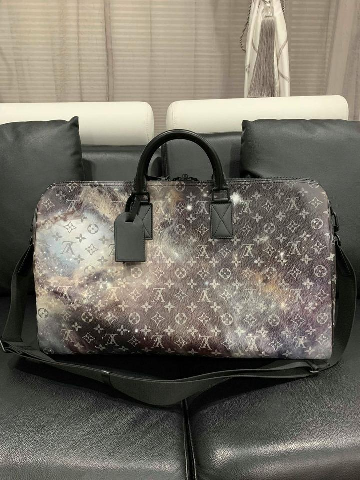 Louis Vuitton Duffle Keepall Galaxy Bandouliere 50 Grey Monogram Logo Lv  Black Canvas Weekend Travel Bag - Tradesy d3a36ec89a518