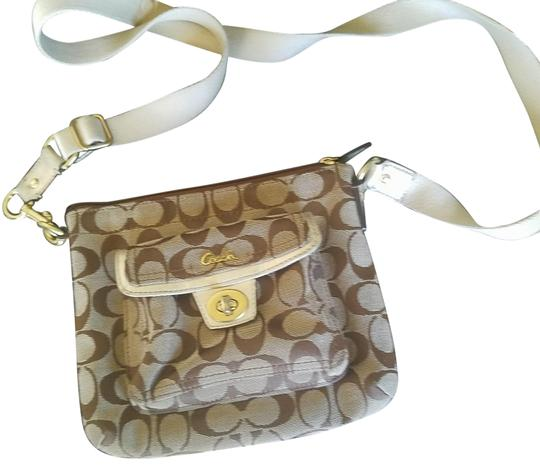 Preload https://img-static.tradesy.com/item/24313048/coach-swingpack-with-accents-brown-and-tangold-canvas-leather-cross-body-bag-0-1-540-540.jpg