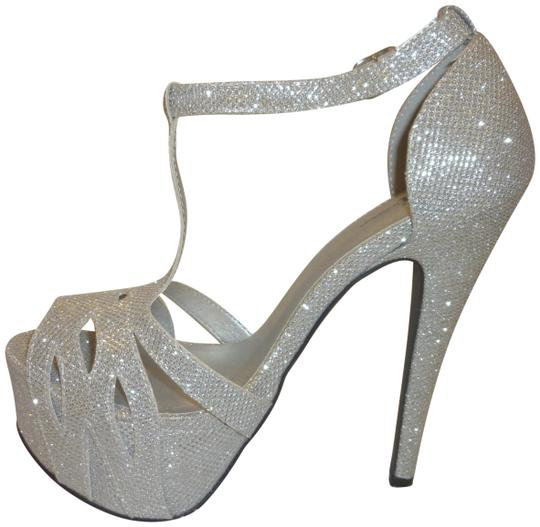 Preload https://img-static.tradesy.com/item/24314041/silver-glitter-stiletto-high-heels-with-a-t-strap-platforms-size-us-75-regular-m-b-0-3-540-540.jpg