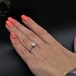 14k White Gold Engagement Features 1.00ct Center Oval Ring