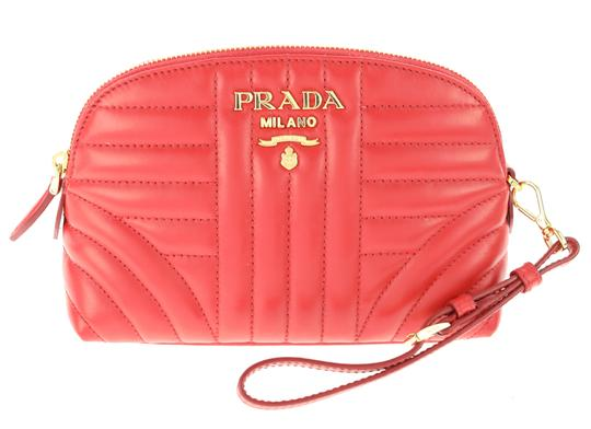 Preload https://img-static.tradesy.com/item/24317832/prada-red-impunture-dome-cosmetic-bag-0-1-540-540.jpg