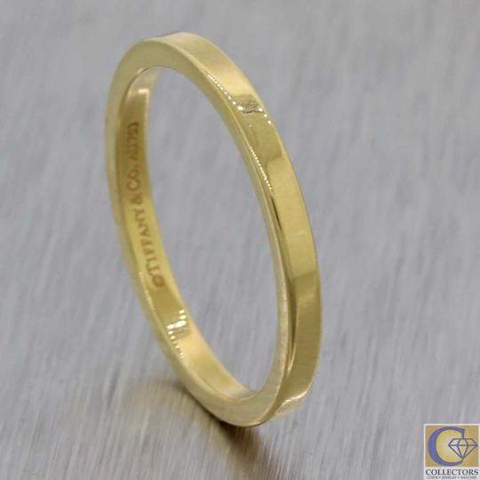 Preload https://img-static.tradesy.com/item/24321472/tiffany-and-co-gold-18k-2mm-wide-classic-stacking-band-ring-0-0-540-540.jpg