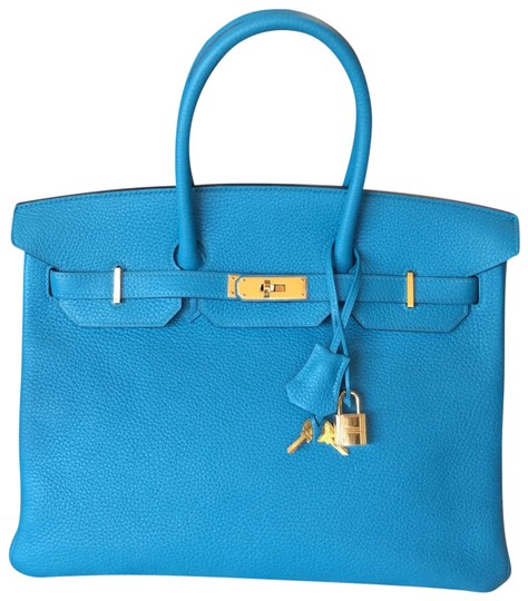 Preload https://img-static.tradesy.com/item/24322544/hermes-birkin-35-cm-with-gold-hardware-blue-aztec-clemence-leather-tote-0-1-540-540.jpg