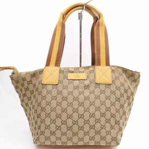 Gucci Speedy Neverfull Tote in tan