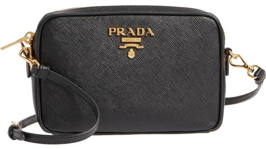 Preload https://img-static.tradesy.com/item/24325755/prada-camera-black-saffiano-leather-cross-body-bag-0-1-540-540.jpg