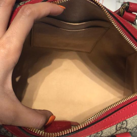 Gucci Satchel in brown,red